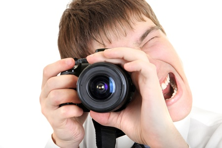 Excited Young Man Take a Picture with a Camera Isolated on the White Background photo