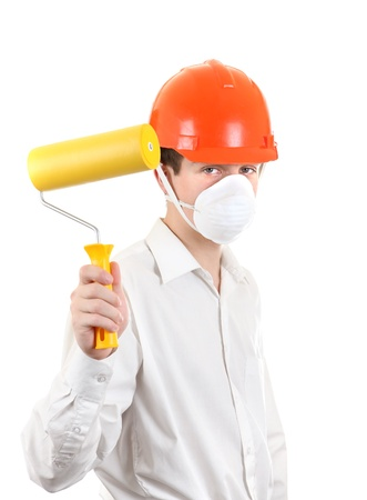 colourer: Young Man in Hard Hat with Paint Roller Isolated on the White Background