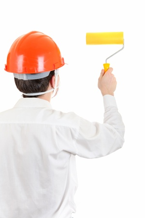 colourer: Rear view of the Man in Hard Hat with Paint Roller Isolated on the White Background