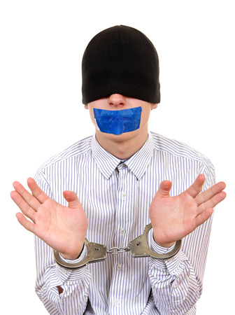Hostage with Sealed Mouth in Handcuffs Isolated on the White Background photo
