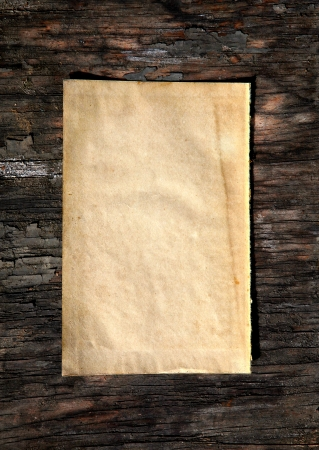 Vintage Paper on old wooden wall background photo