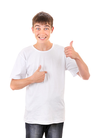 Cheerful Young Man Pointing with a finger at Himself. Isolated On The White Background photo
