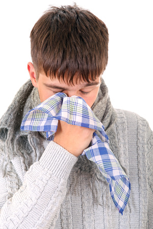 diseased: Diseased Young Man in sweater with handkerchief. Isolated on the White Background