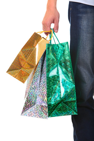 Shopping Bags in a Male Hand Closeup Isolated On The White Background photo