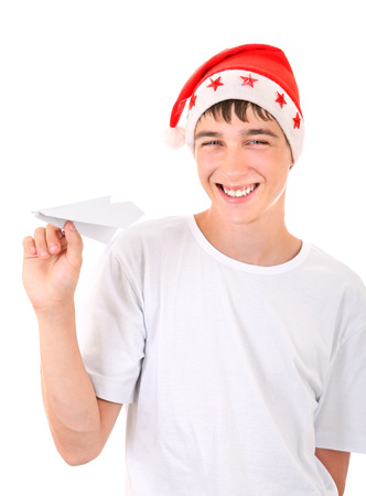Happy Teenager in Santa's Hat with Paper Plane Isolated On The White Background photo