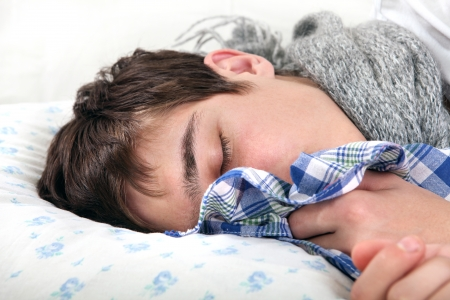 hanky: Sick Young Man sleeps with Hanky closeup