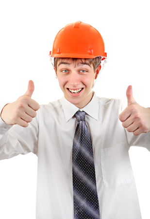 Happy Teenager in Hard Hat showing thumb up Isolated on the white  Stock Photo - 23198800
