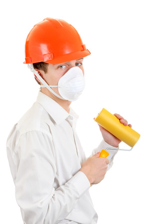 colourer: Young Man in Hard Hat with Paint Roller Isolated on the White