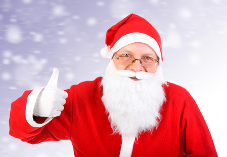 Happy Santa Claus with OK Gesture on the Abstract Winter  photo