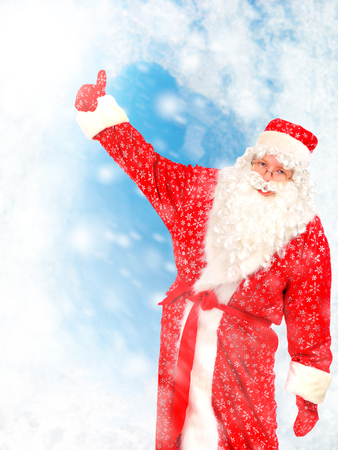 Happy Santa Claus with Hand Up on the Abstract Winter  photo