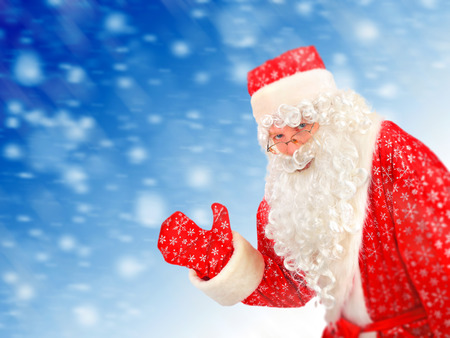 Happy Santa Claus on the Abstract Winter Background photo