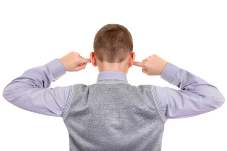 occiput: Rear view of a Boy with cover Ears Isolated on the White Background