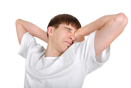 wearied: Tired Young Man Isolated on the White Background Stock Photo