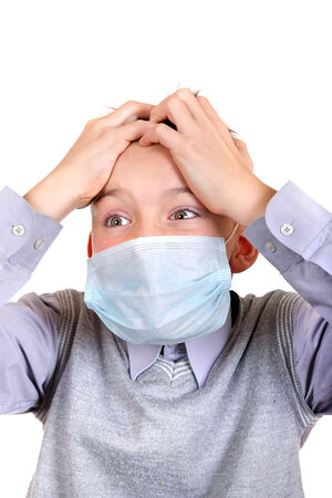 Worried Boy in Flu Mask Isolated on the White Background Stock Photo - 23911343