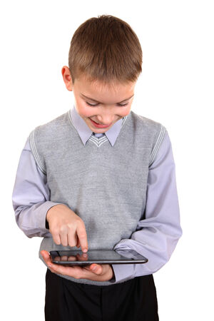 gladden: Cheerful Boy using Tablet Computer Isolated on the White Background