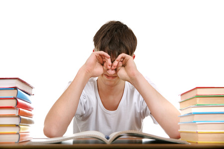 to rub: Tired Student Rub his Eyes Isolated on the White Background Stock Photo