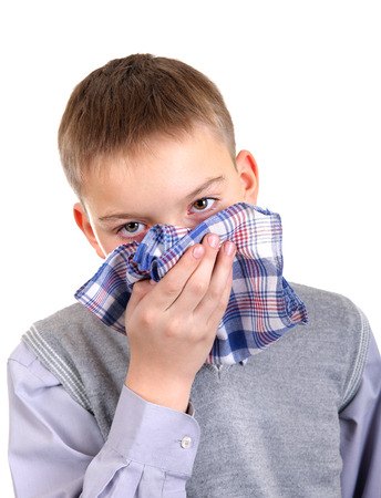 Sick Young Boy Isolated on the White Background Stock Photo - 23911361