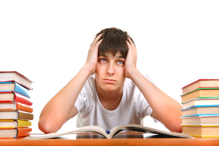 Sad and Tired Student after Hard Work for Exam Isolated on the White Background photo
