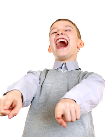 derision: Boy pointing and Laughing. Isolated on the White Background Stock Photo