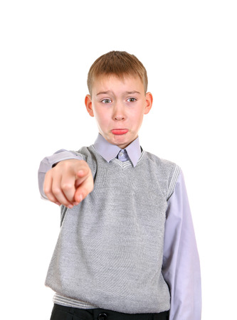 vindictive: Offended Boy pointing at You. Isolated on the White Background Stock Photo