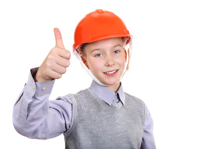 Boy in Hard Hat with Thumb Up Gesture Isolated on the White Background photo