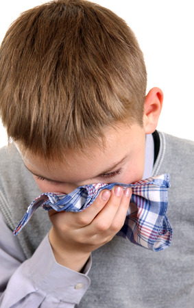 Sick Young Boy Isolated on the White Background Stock Photo - 24095758