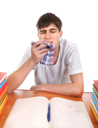 Sick Student at the School Desk Isolated on the white background Stock Photo - 24095763