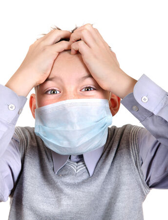 Worried Boy in Flu Mask Isolated on the White Background photo