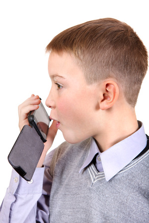 Cheerful Boy with Cellphone Isolated on the White Background photo