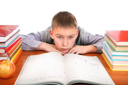 Bored and Tired Boy on the School Desk Isolated on the white background photo