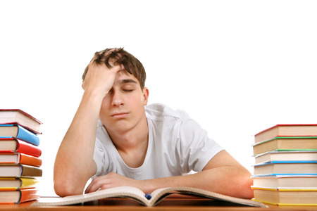 wearied: Sad and Tired Student on the School Desk Isolated on the White Background