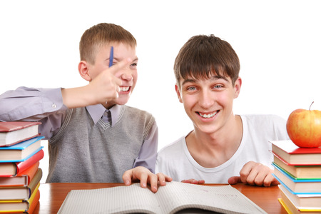 helps: Cheerful Older and Little Brothers doing homework together Isolated on the White Background