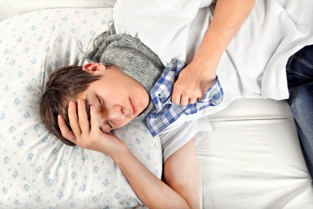 Sick Young Man feels Headache and lying on the Bed Stock Photo - 25039143