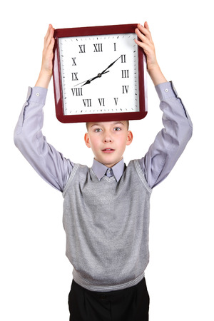 Surprised Boy with Big Clock Isolated on the White Background photo
