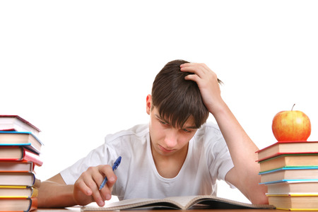 Tired Student at the School Desk Isolated on the White Background photo