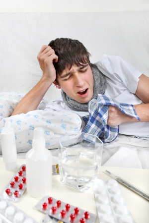 Young Man fell ill and Lying on the Bed with Handkerchief Stock Photo - 25216729