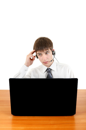 Pensive Young Man in Headset is Thinking at the Desk with Laptop Isolated on the White Stock Photo