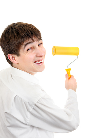 colourer: Teenager Portrait with Paint Roller Isolated on the White Background