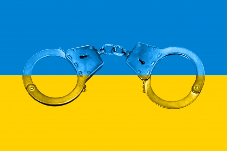 Concept of National Ukrainian Flag and Handcuffs photo