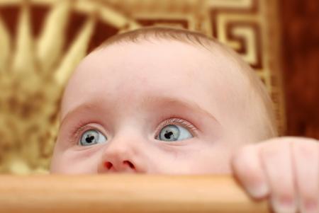 bassinet: Surprised Little Baby Portrait in Bassinet Closeup Stock Photo