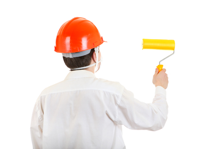 colourer: Back view of the Man in Hard Hat with Paint Roller Isolated on the White  Stock Photo