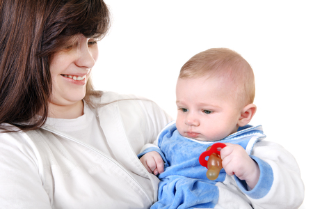 Young Mother holds the beautiful Baby Boy Isolated on the White  Stock Photo - 25390982