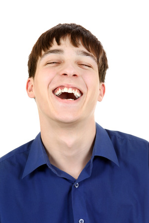 Happy Teenager Hysterical Laughing Isolated on The White  photo