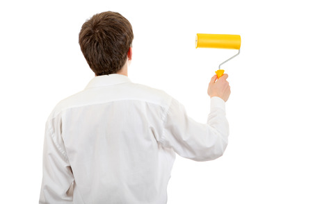 colourer: Rear view of the Young Man with Paint Roller Isolated on the White
