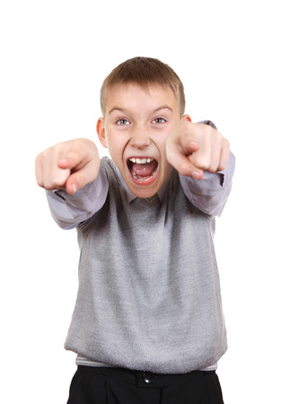 derision: Boy pointing and Laughing. Isolated on the White  Stock Photo