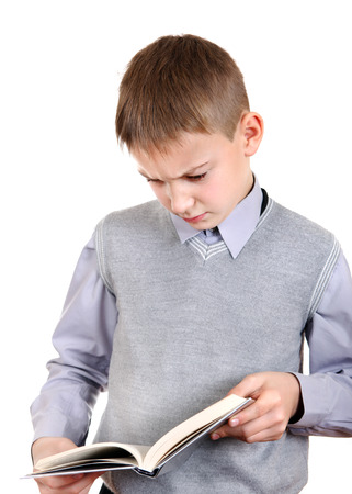 ennui: Annoyed Boy reads a Book Isolated on the White