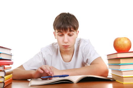 wearied: Tired Student at the School Desk Isolated on the White