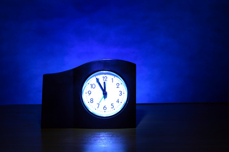 almost: Clock in the Dark Room with display Almost Midnight
