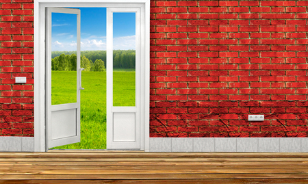 Opened door in the Room to Nature with sky and green field photo