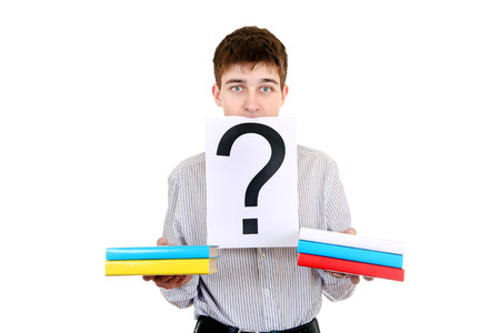 ques: Serious Student with the Books and Question Mark Isolated on the White Background